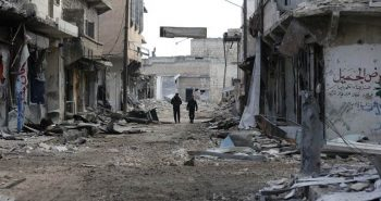 In this Saturday, Dec. 3, 2016 photo, Syrian army soldiers patrol the east Aleppo neighborhood of Tariq al-Bab, Syria. As the battle for Aleppo winds down after more than four years of brutal street fighting and punishing aerial bombardments, the staggering extent of destruction begins to emerge: Tens of thousands of homes and apartments have been rendered uninhabitable, most factories have been looted or destroyed and some ancient landmarks have been reduced to rubble. (AP Photo/Hassan Ammar)