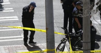 US: 3 officers injured; 1 suspect dead, 2 in custody in Seattle store robbery