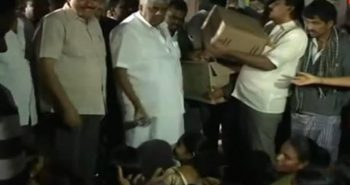 PWD Minister Revanna visited camps and Throws Biscuit