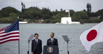 HONOLULU, HI - DECEMBER 27: U.S. President Barack Obama delivers remarks while Japanese Prime Minister Shinzo Abe listens at Joint Base Pearl Harbor Hickam's Kilo Pier on December 27, 2016 in Honolulu, Hawaii. Abe is the first Japanese prime minister to visit Pearl Harbor with a U.S. president and the first to visit the USS Arizona Memorial. (Photo by Kent Nishimura/Getty Images)